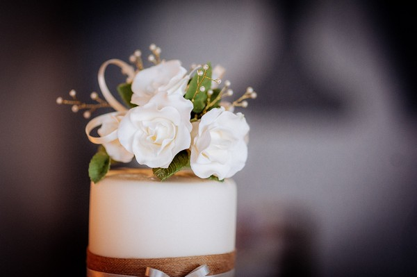 White flowers on top of wedding cake