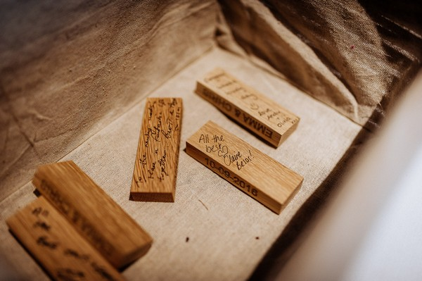 Jenga pieces with wedding guests' messages written on