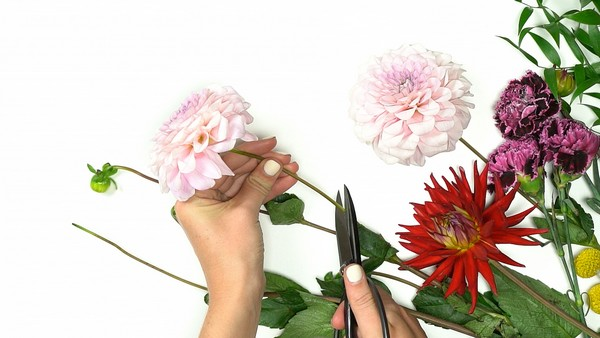 Attaching flowers to large wire wreath
