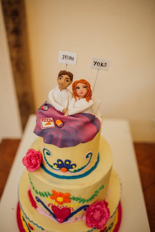 Wedding cake with John and Yoko cake topper