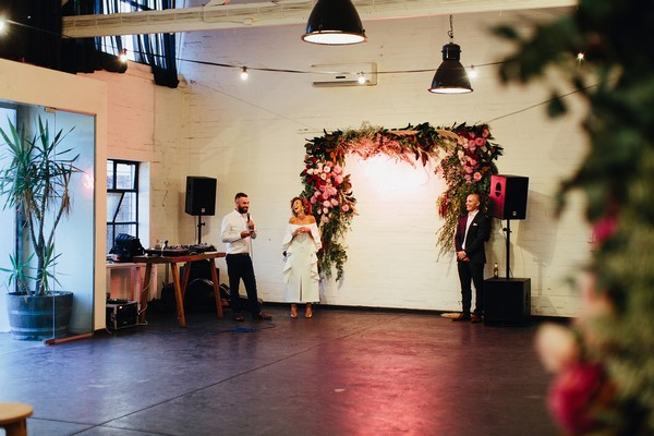 Groom wedding speech in warehouse