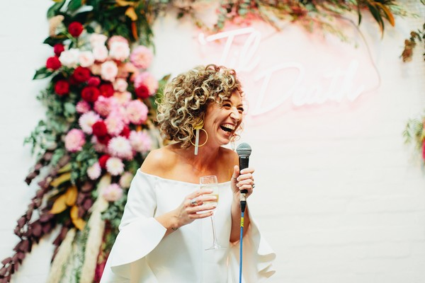 Bride laughing giving speech