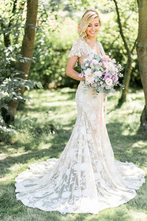 Bride with long wedding dress holding bouquet