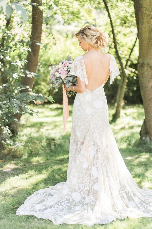 Bride's wearing open-back wedding dress
