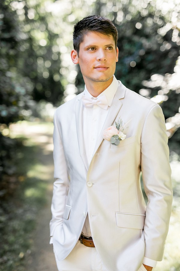 Groom wearing light grey suit