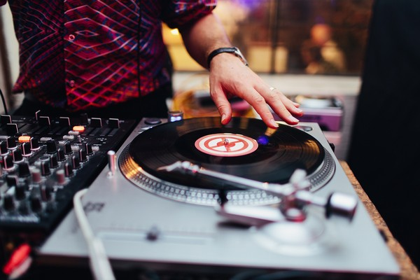 Record on DJ's turntable