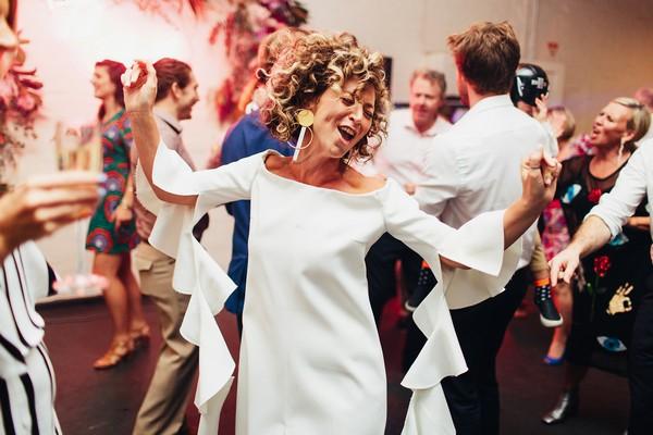 Bride dancing enthusiastically