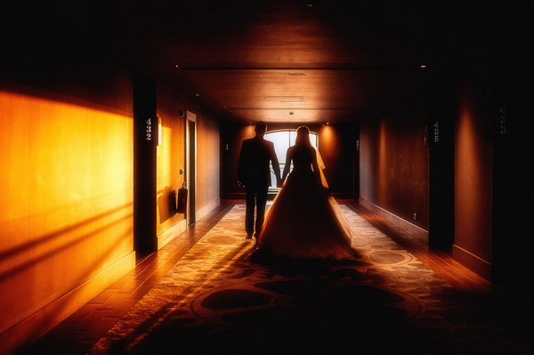 Bride and groom walking down corridor of the Titanic Hotel Liverpool