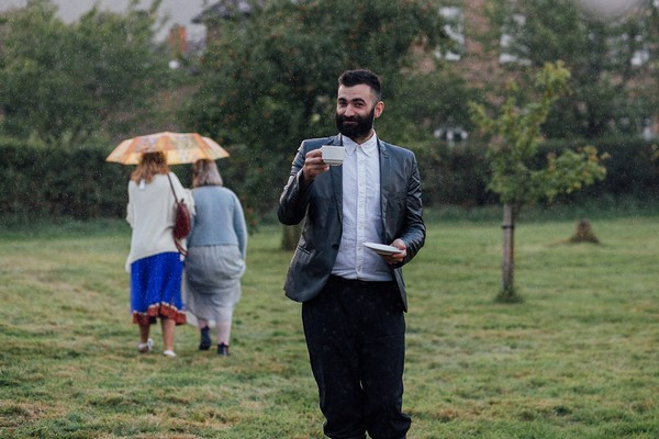 Wedding guest with cup of tea