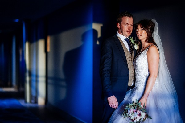 Bride and groom in corridor of the Titanic Hotel Liverpool