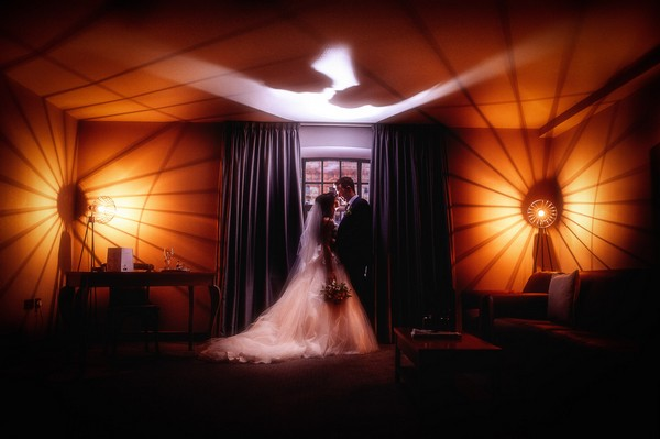 Bride and groom standing in front of window inside the Titanic Hotel Liverpool