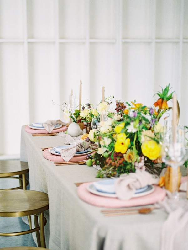 Floral wedding table centrepiece with yellow flowers