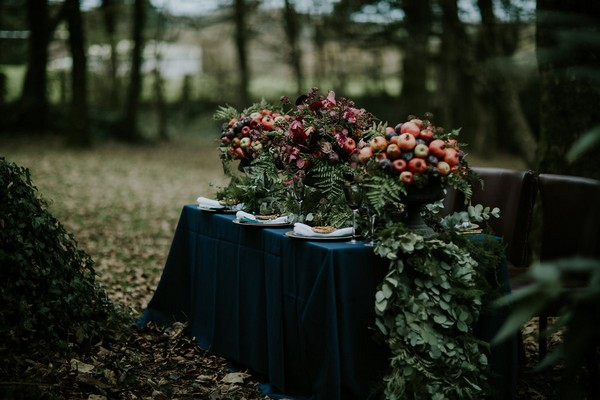 Wedding table with dark blue tablecloth