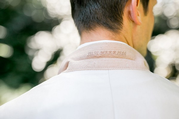 Just married written under groom's collar