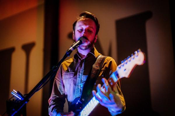 Wedding band guitarist singing
