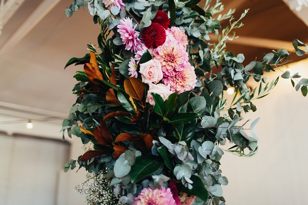 Wedding flowers and foliage on pillar