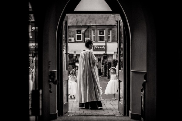 Vicar waiting for bride outside church