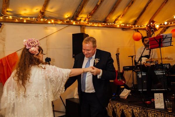 Bride dancing with man