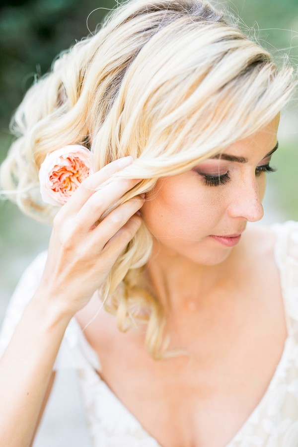 Bride with updo hairstyle with flower in hair