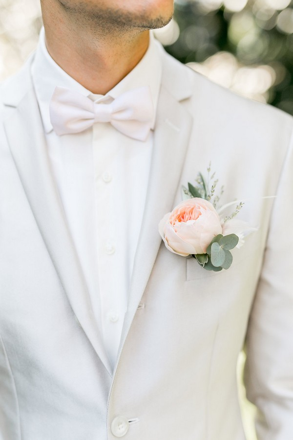 Groom's peach flower buttonhole