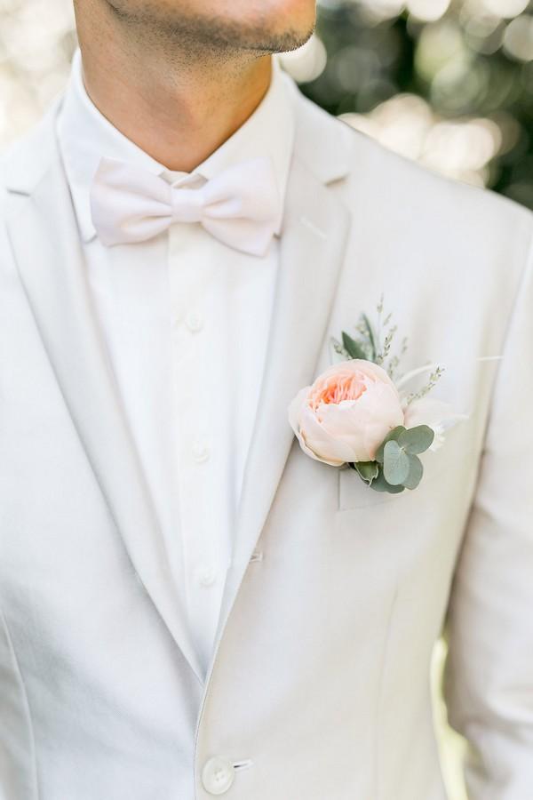 Groom's peach flower buttonhole