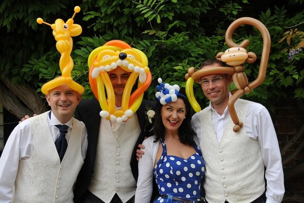 Wedding Guests with Balloon Models on their Heads