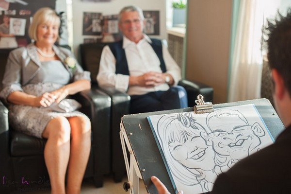 Caricaturist Drawing Couple