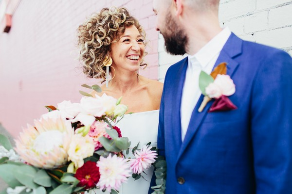 Bride with big smile looking at groom