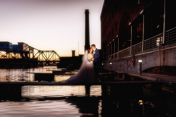Bride and groom kissing at Liverpool Dock