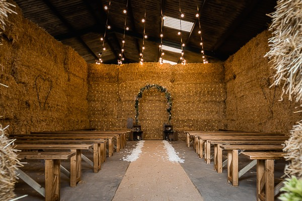 Wedding ceremony seating in cow shed