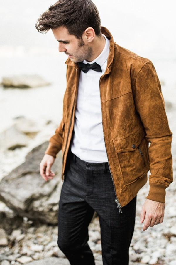 Groom wearing tan suede jacket