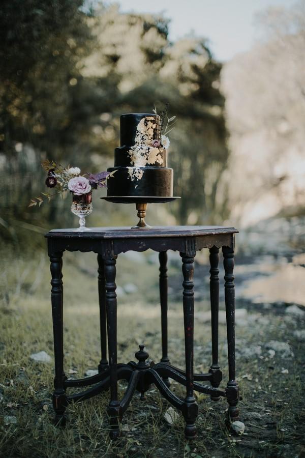 Black wedding cake on table