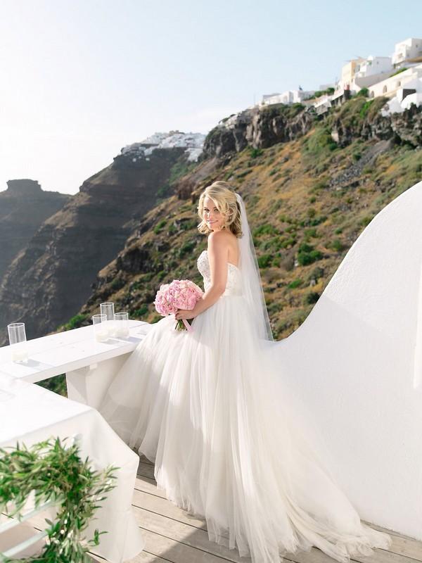 Bride on balcony in Santorini