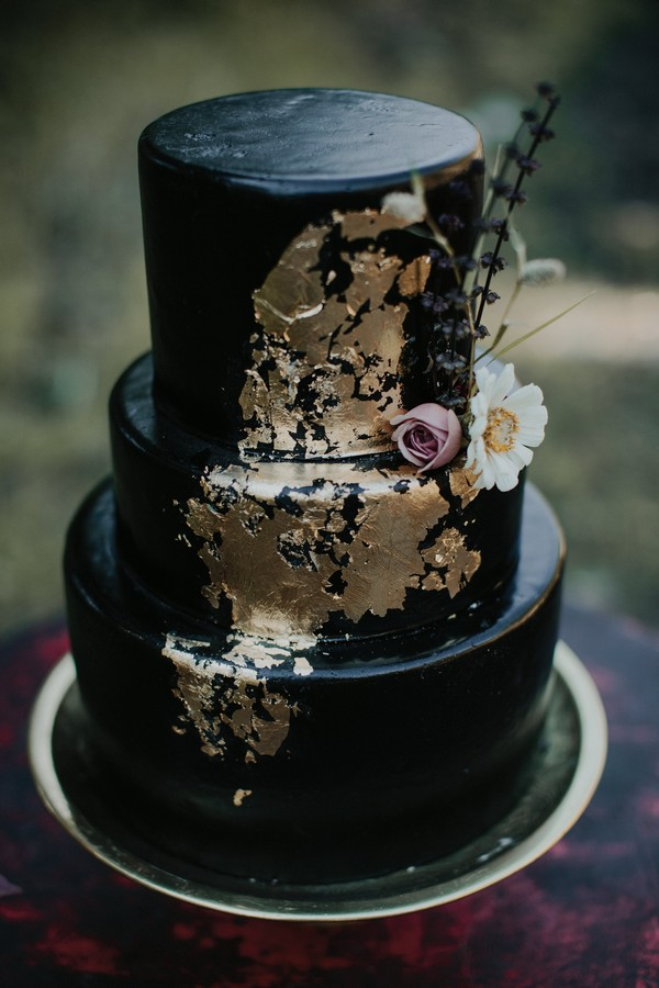 Black wedding cake with gold leaf
