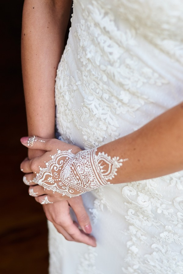 Bride with pattern painted on hand
