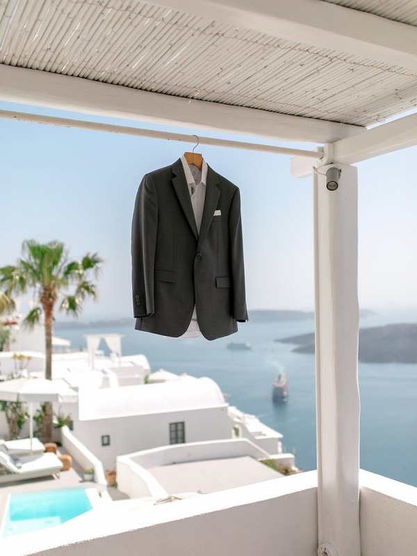 Groom's suit jacket hanging from canopy