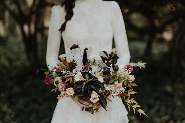 Bride holding autumn wedding bouquet