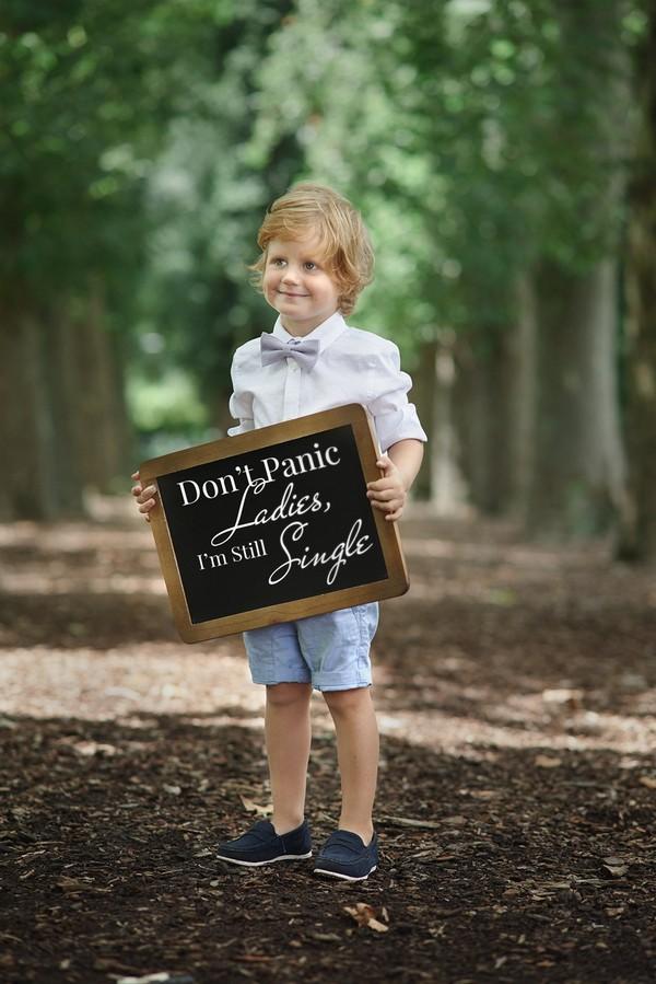 Pageboy holding wedding sign