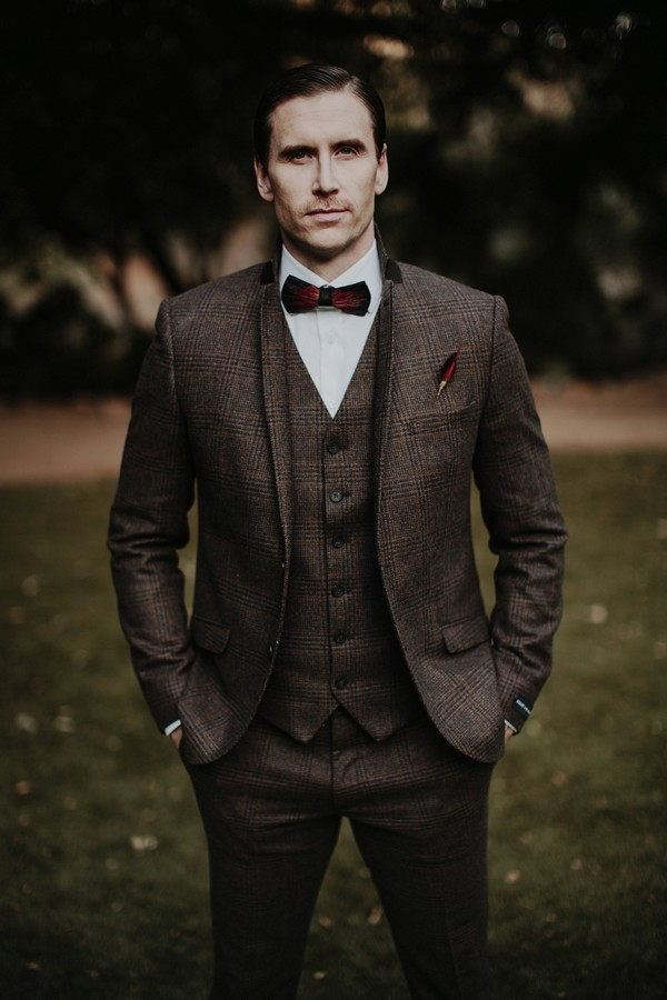 Groom in tweed with hands in pockets