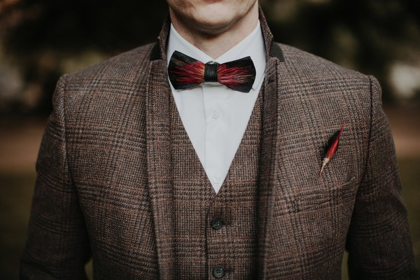 Tweed waistcoat and jacket with bow tie and feather buttonhole
