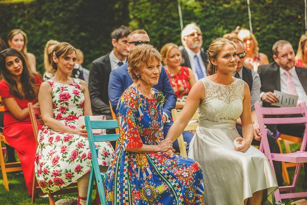 Mother watching as daughter gets married