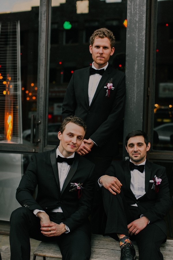 Groomsmen wearing suits and bow ties
