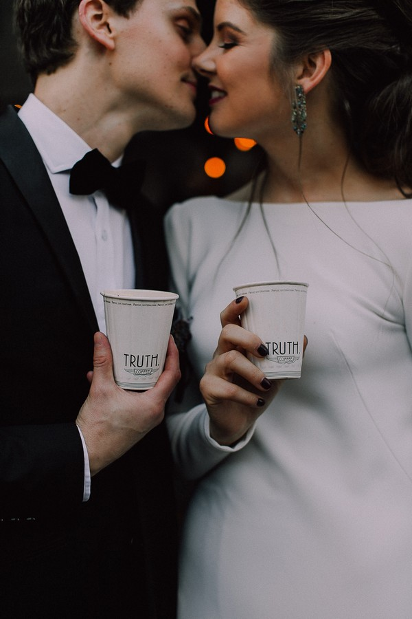 Bride and groom holding Truth coffee cups