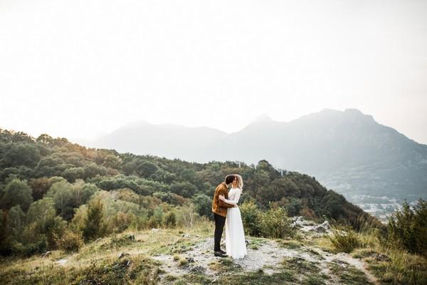 Bride and groom at top of mountain at Lake Como