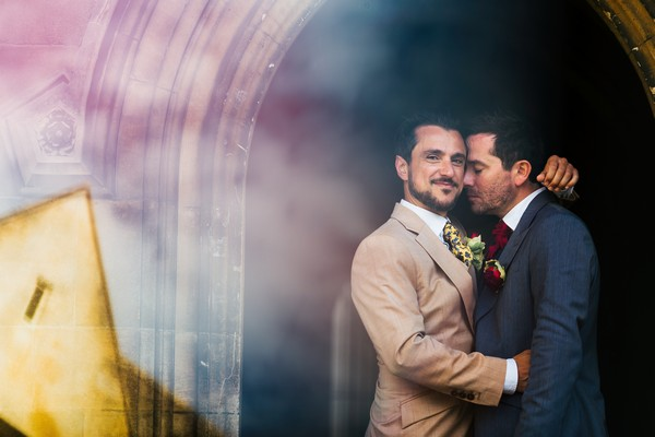 Grooms hugging outside Kings College in Cambridge - Picture by Rafe Abrook Photography