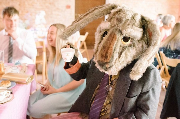 Wedding guest wearing rabbit costume head holding tea cup - Picture by Gabrielle Bower Photography