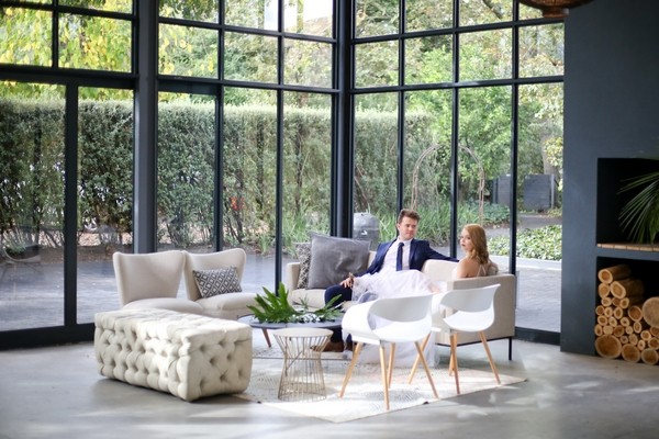 Bride and groom sitting in The Conservatory Franschhoek
