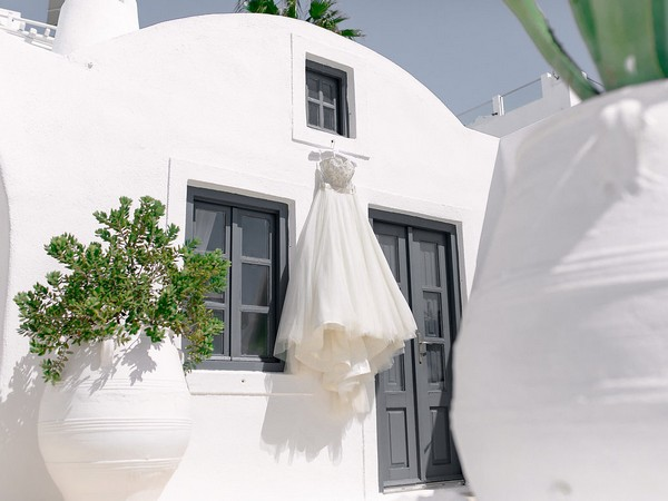 Wedding dress hanging outside apartment in Santorini