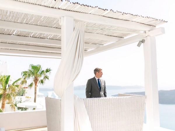 Groom waiting for bride before elopement in Santorini