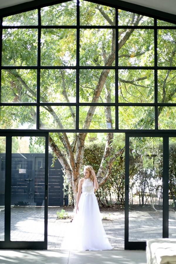 Bride standing at door of The Conservatory Franschhoek